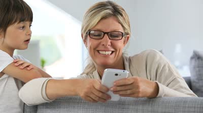 stock-footage-mother-using-smartphone