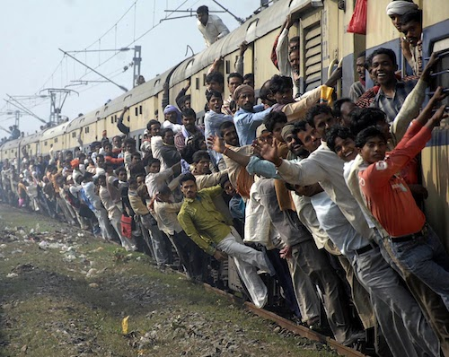 Passengers travel in an overcrowded train in the eastern Indian city of Patna February 23, 2010. India's Railway Minister Mamata Banerjee will present the annual railway budget before parliament on February 24. REUTERS/Krishna Murari Kishan (INDIA - Tags: BUSINESS IMAGES OF THE DAY TRANSPORT)