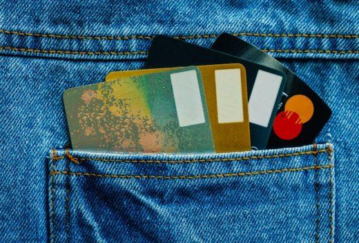 Credit cards in back of pocket blue denim jean for business and finance concept